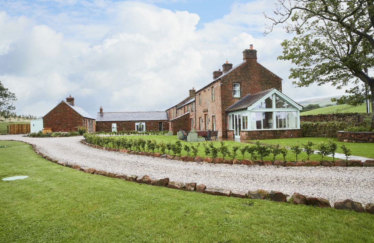 The traditional farm house and cottage are set within the Rowley Estates farmland with spectacular views all around