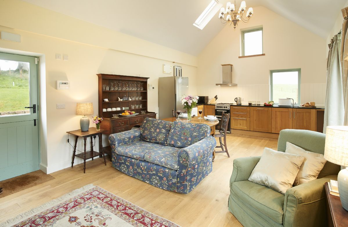 Ground floor: Open plan kitchen, dining and sitting room with wood burner