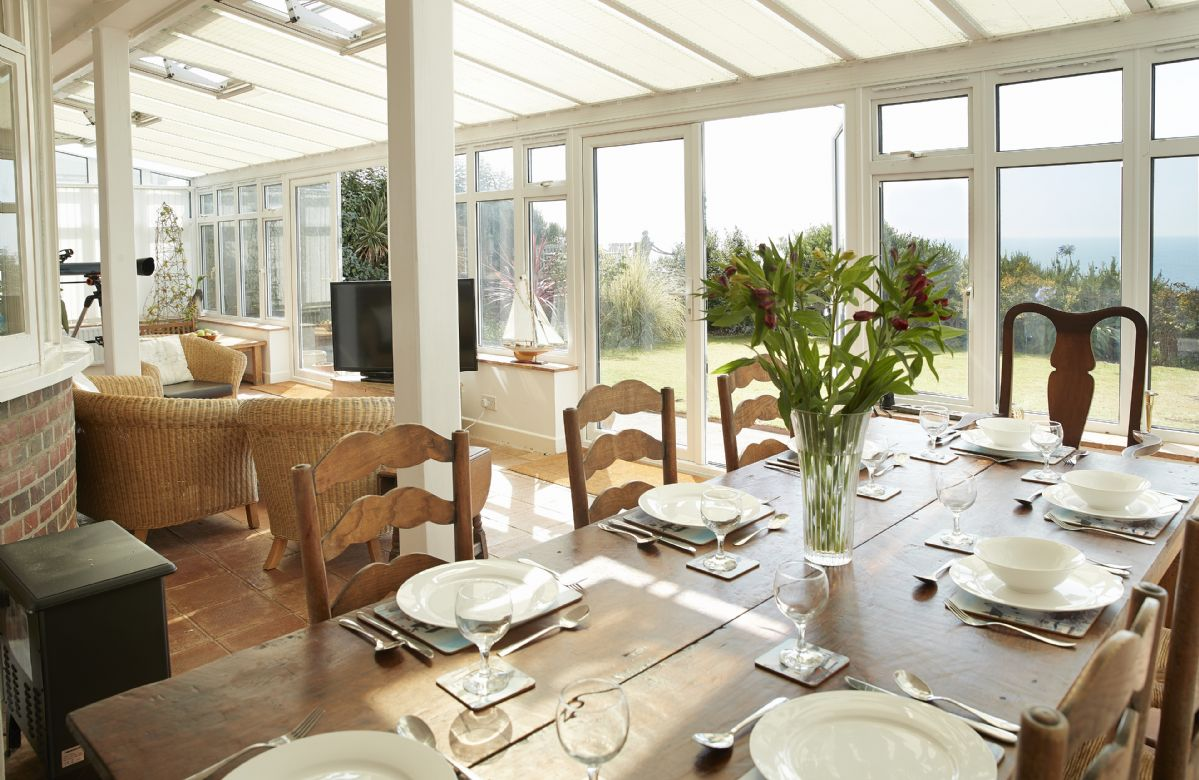 Ground floor: Dining table in the conservatory seating eight guests and seating area