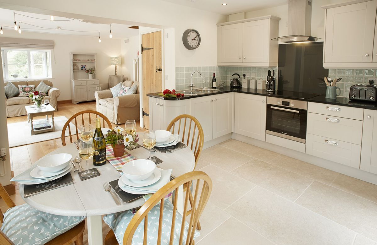 Ground floor: Open plan fully equipped kitchen and dining table seating four guests