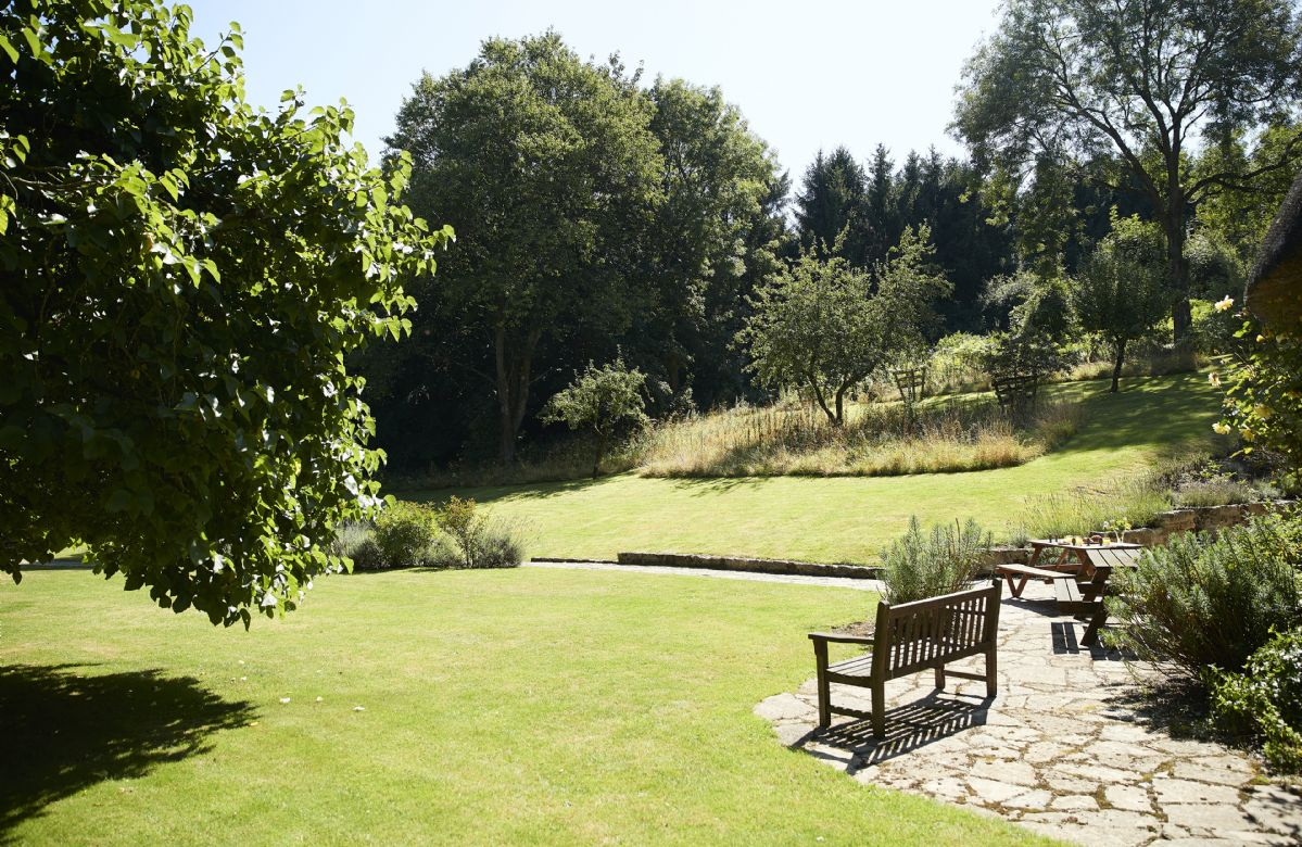 Stunning gardens all around the cottage with seating