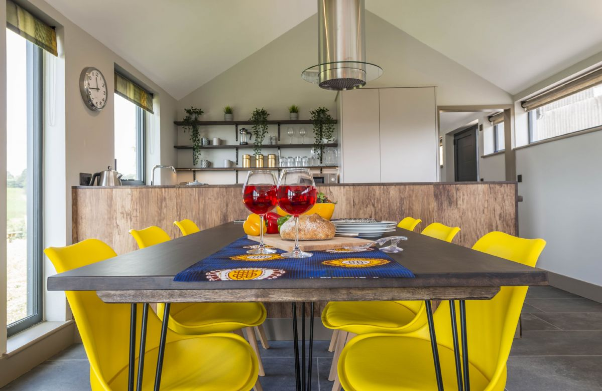 Ground floor: Vibrant dining area, leading to kitchen