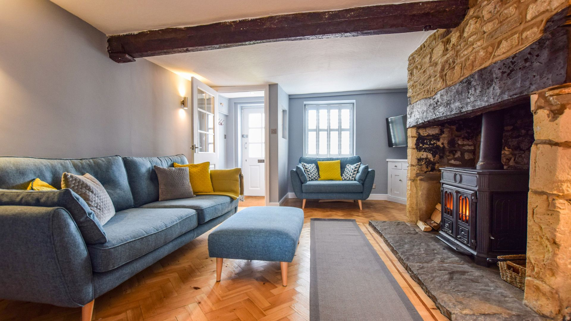 Sitting Room with log burner, 27 Horsefair, Bolthole Retreats