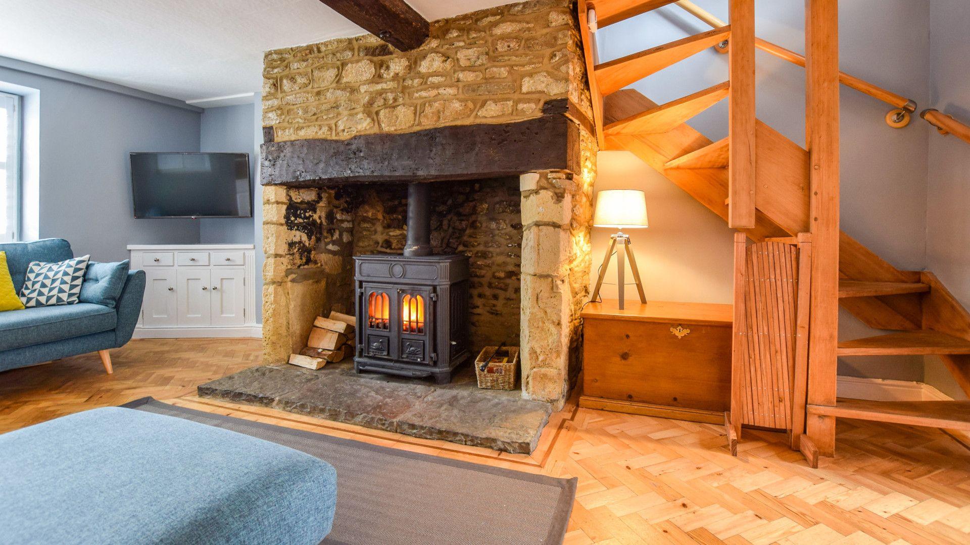 Sitting Room with wood burner,  27 Horsefair, Bolthole Retreats