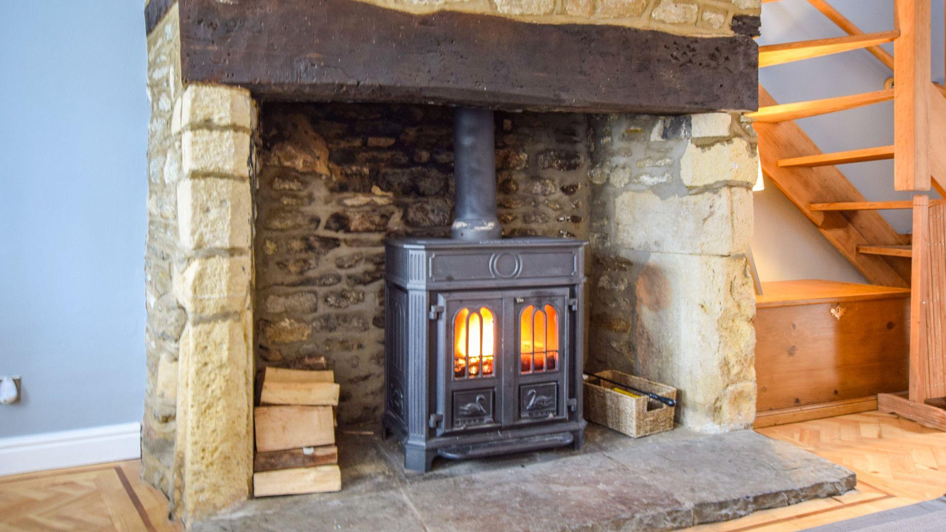 Wood burner in original stone fireplace,  27 Horsefair, Bolthole Retreats