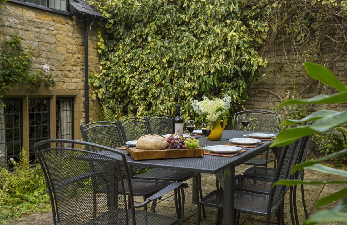 Enjoy dining al fresco in the pretty and enclosed garden