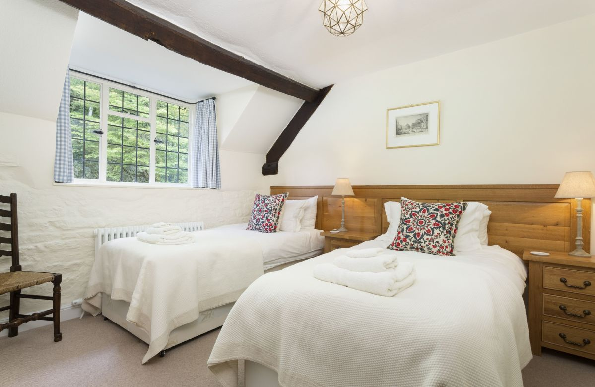 First floor: Twin bedroom with two 3' zip and link beds which can convert to double upon request