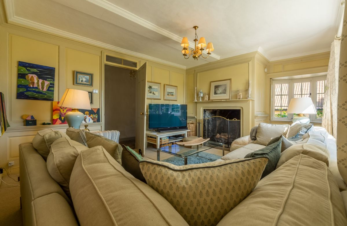 Ground floor: Snug with open fire, paneled walls and television