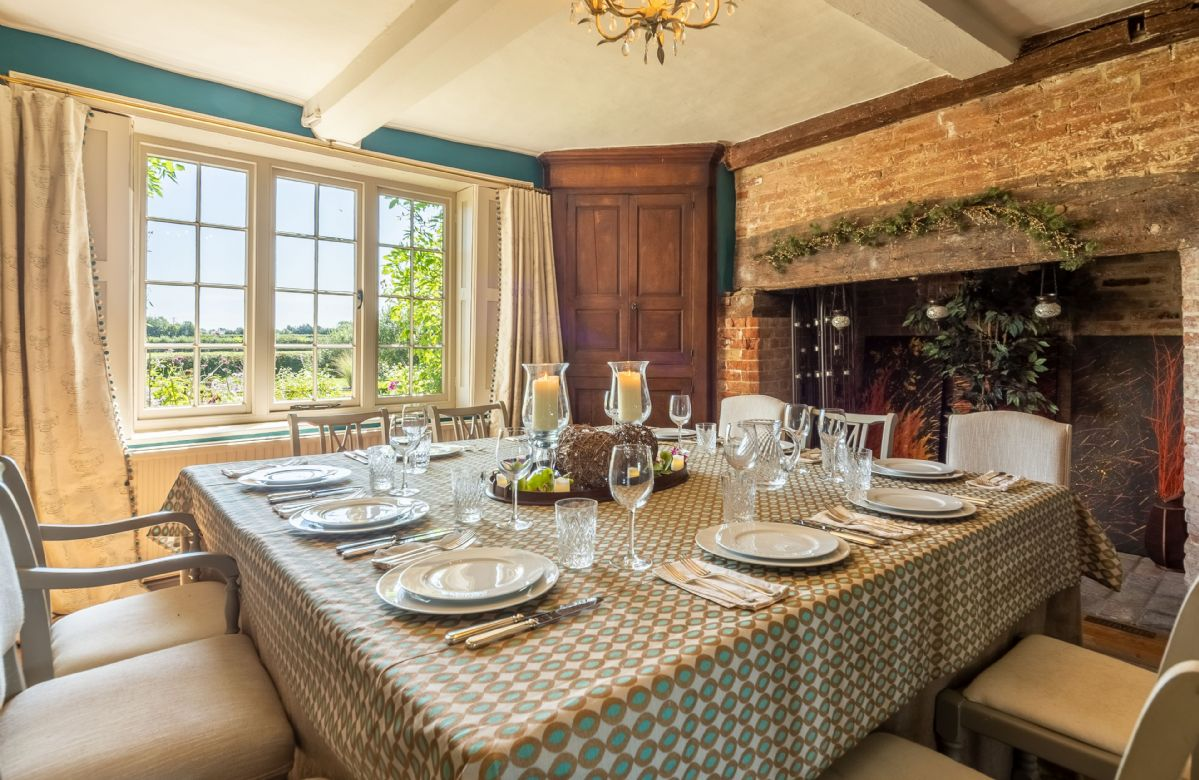 Ground floor: Dining room with table and chairs to seat twelve