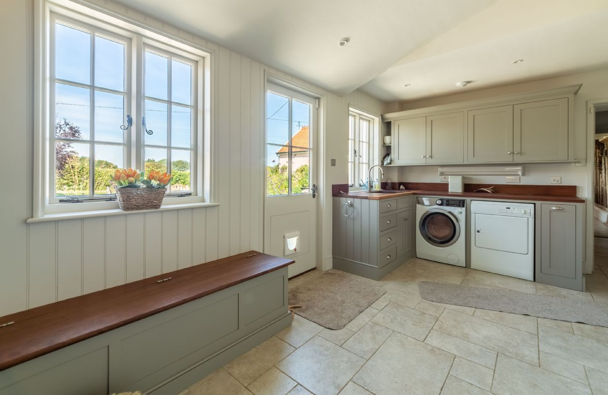 Ground floor: Utility room with washing machine, tumble dryer and sink