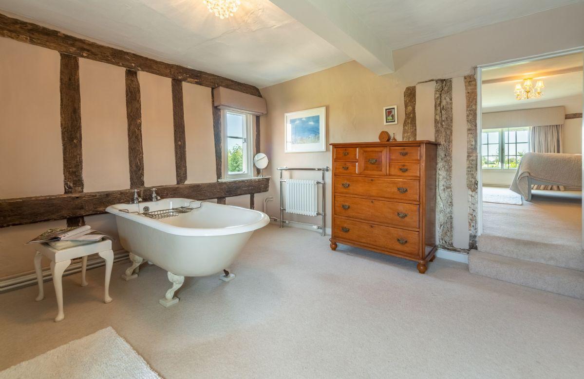 First floor: En-suite bathroom with freestanding bath