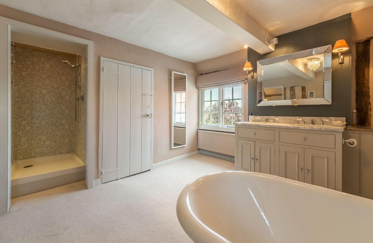 First floor: En-suite bathroom with separate shower