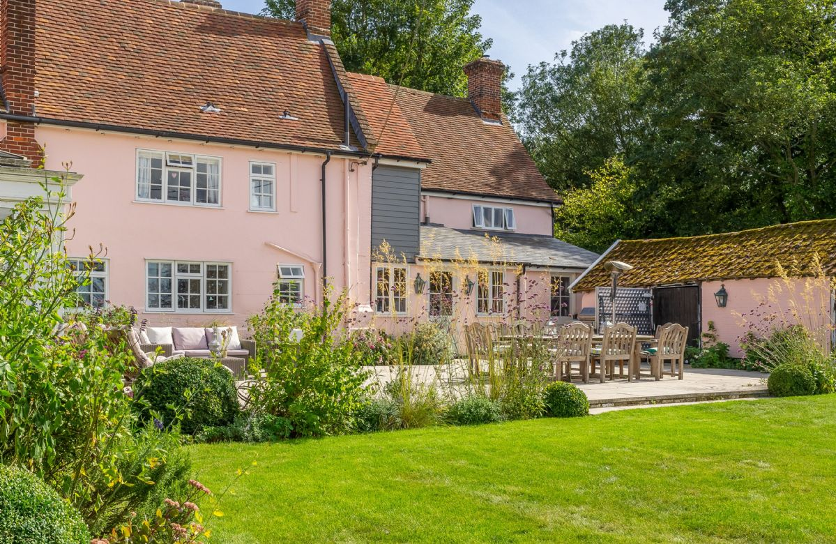 The rear of the house with patio and garden furniture