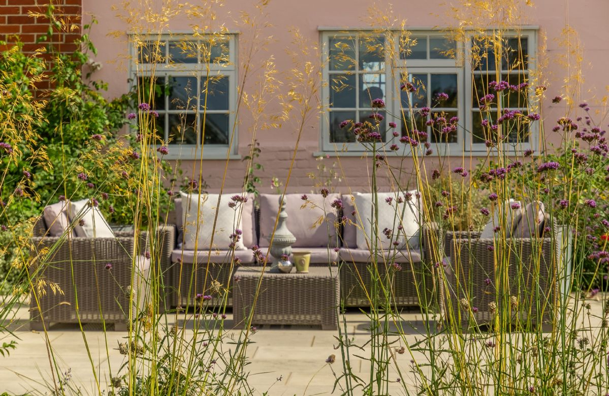 The patio area with comfortable seating