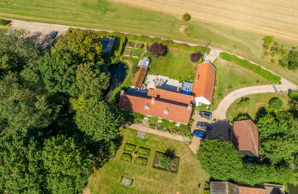 Aerial view of the hall with surrounding gardens