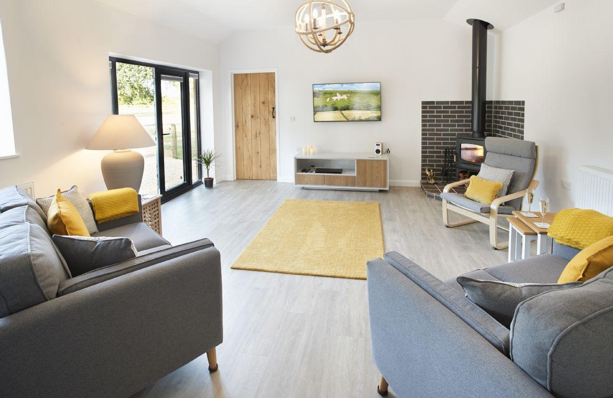 Ground floor: Spacious open plan sitting room with wood burner