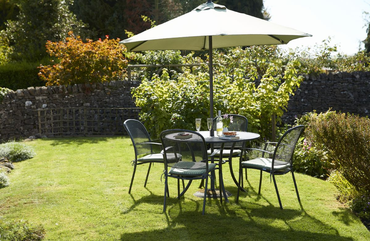 Beautiful lawn with garden table seating four guests