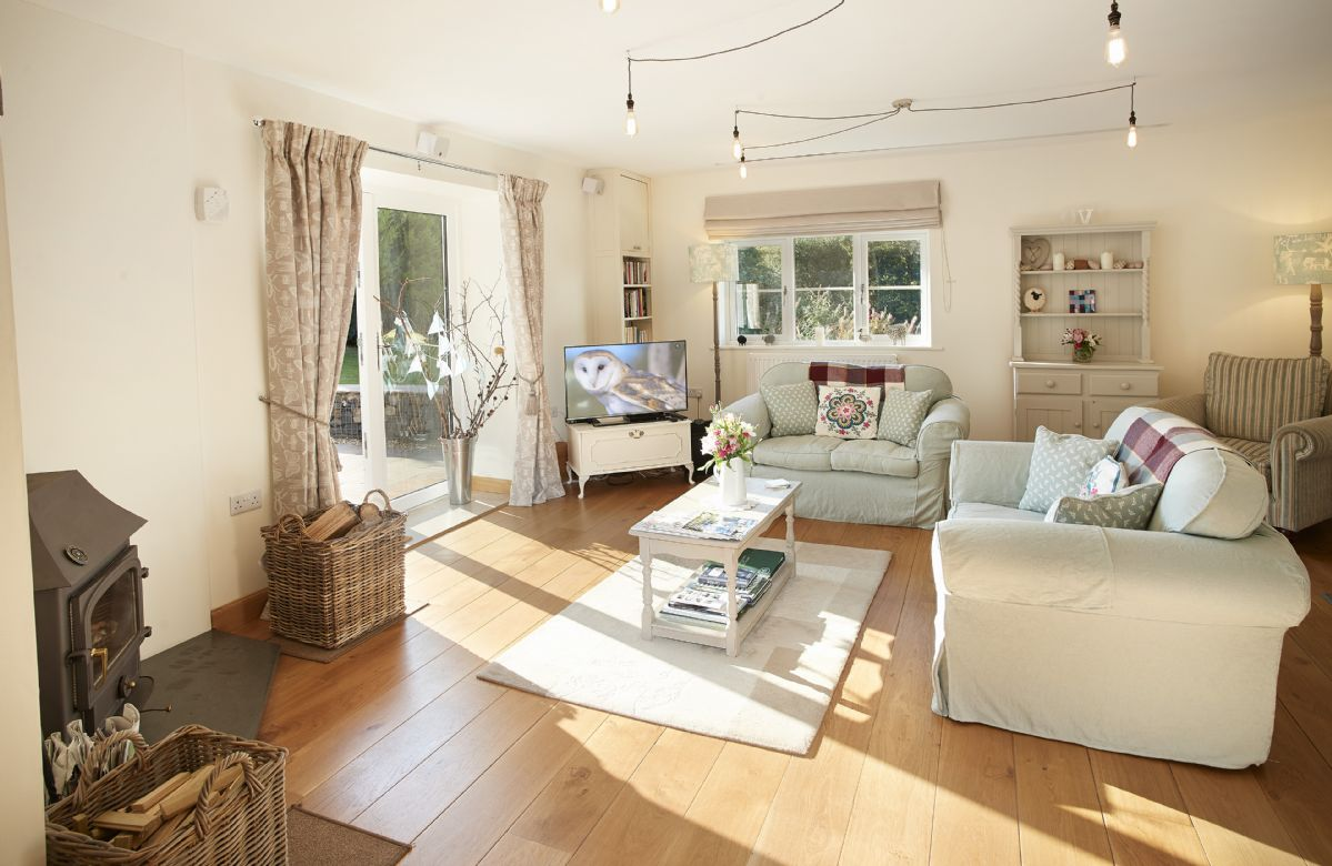 Ground floor: Open plan sitting room with wood burning stove