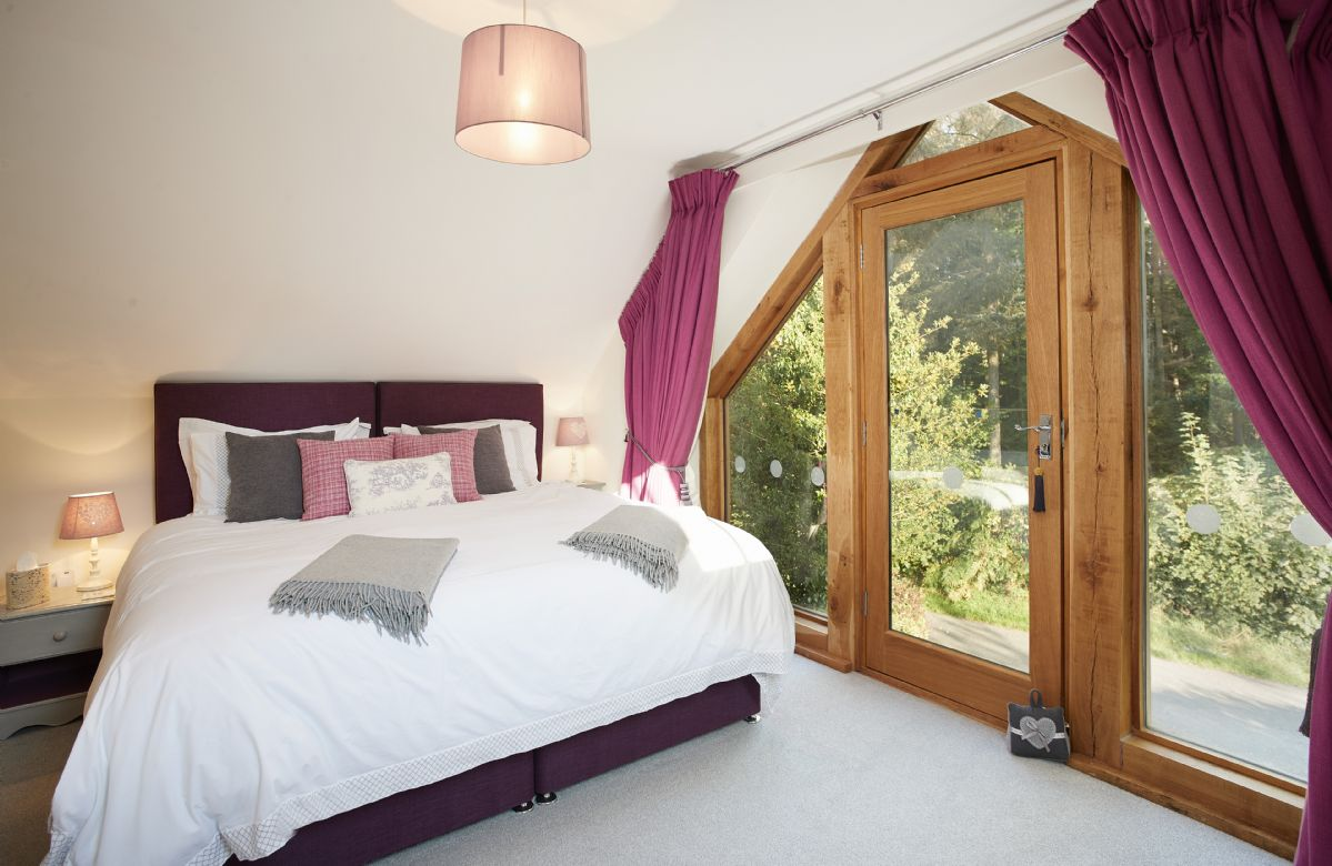 First floor: Master bedroom with 6' super king size zip and link bed and en-suite shower room