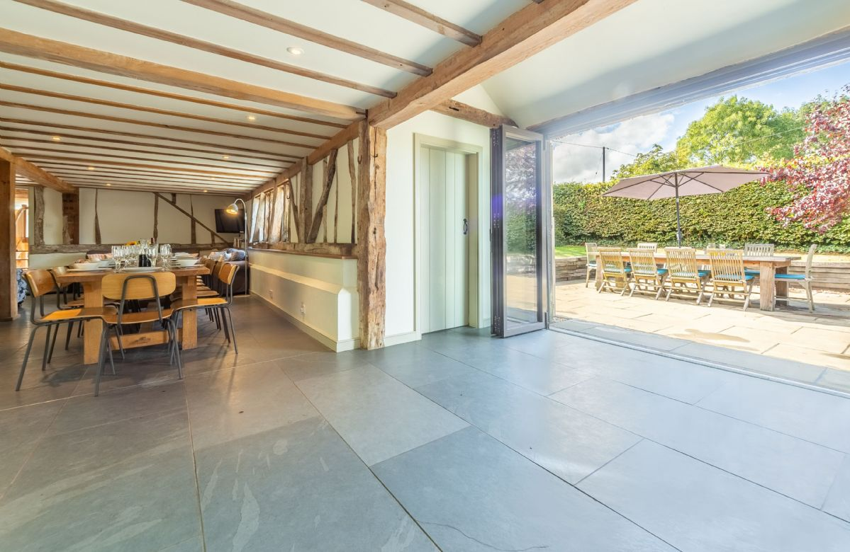 Ground floor: Entrance hall with bi-folding doors leading to garden sitting area
