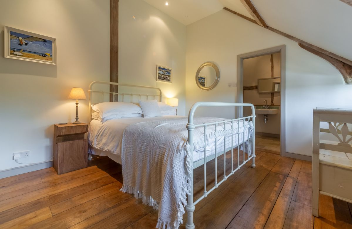 First floor: Bedroom three with standard double bed