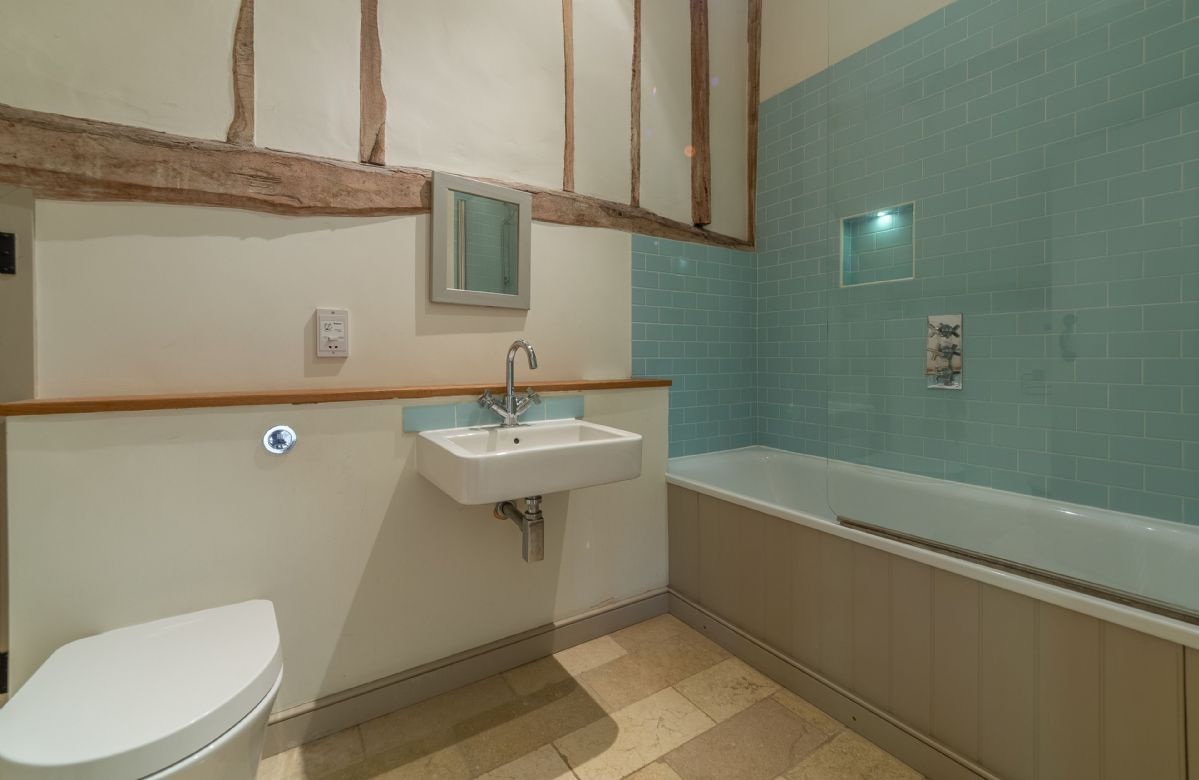 First floor: Master bedroom en-suite with shower over the bath and access to Dormitory via separate door