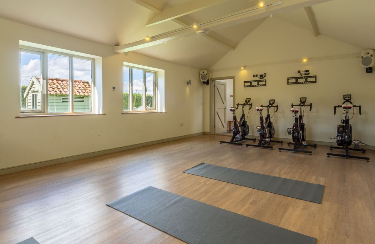 Butley Barn: Gym space with exercise bikes and yoga mats