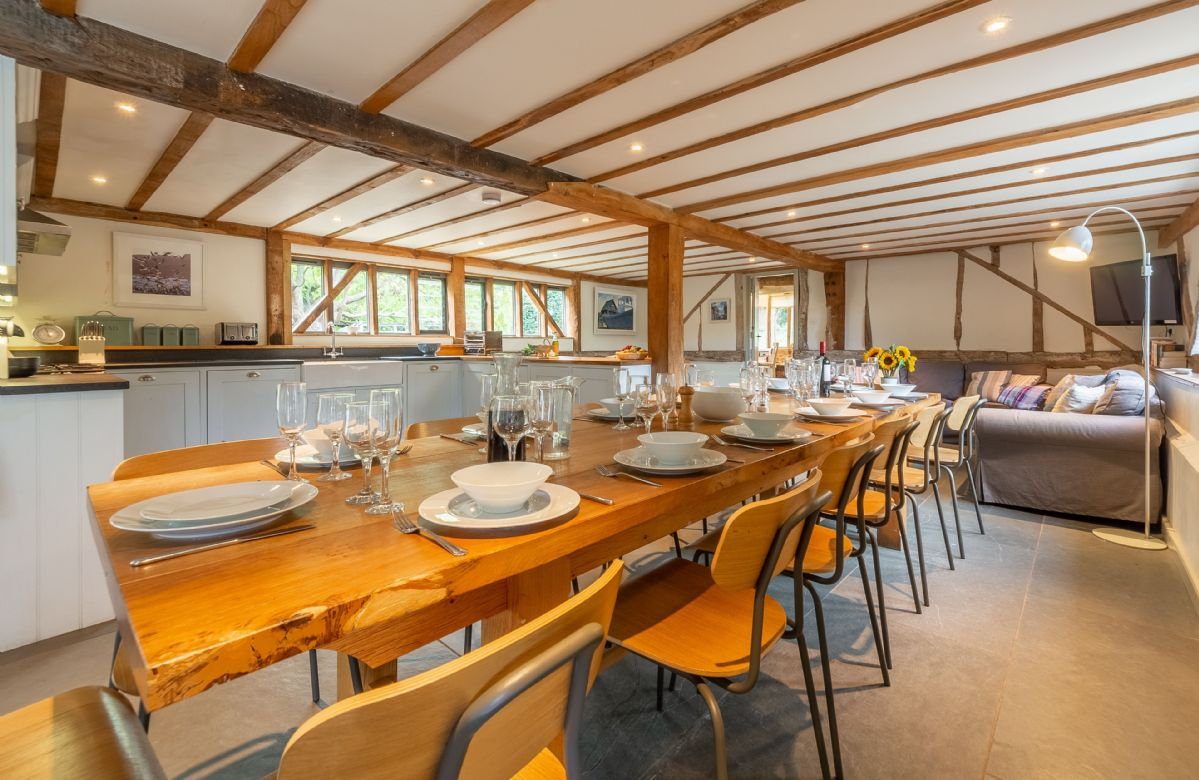 Butley Barn ground floor: Open plan living with dining table seating up to 20 dinner guests