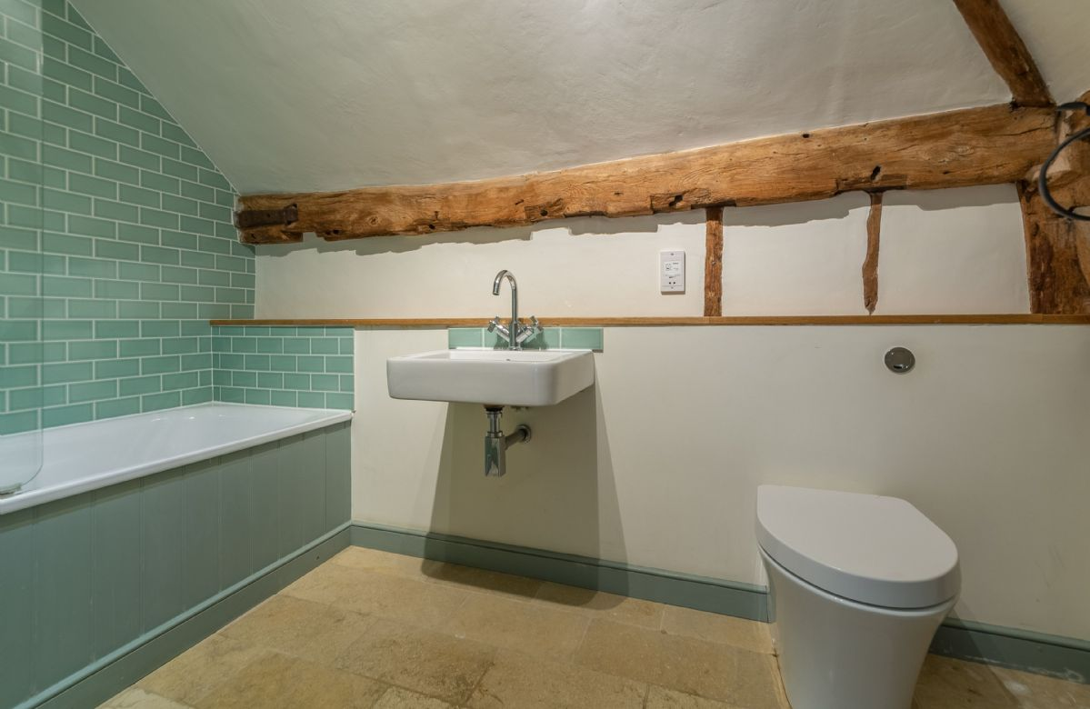 Butley Barn first floor: Bedroom two en-suite with shower over the bath