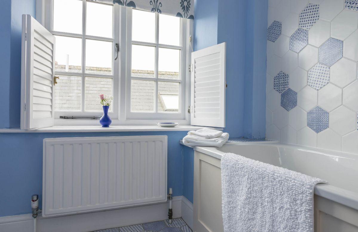 First floor: En-suite bathroom with bath and shower
