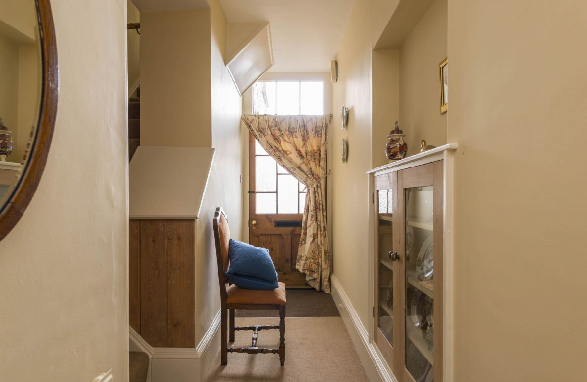 Ground floor: Hallway leading into the sitting room and kitchen