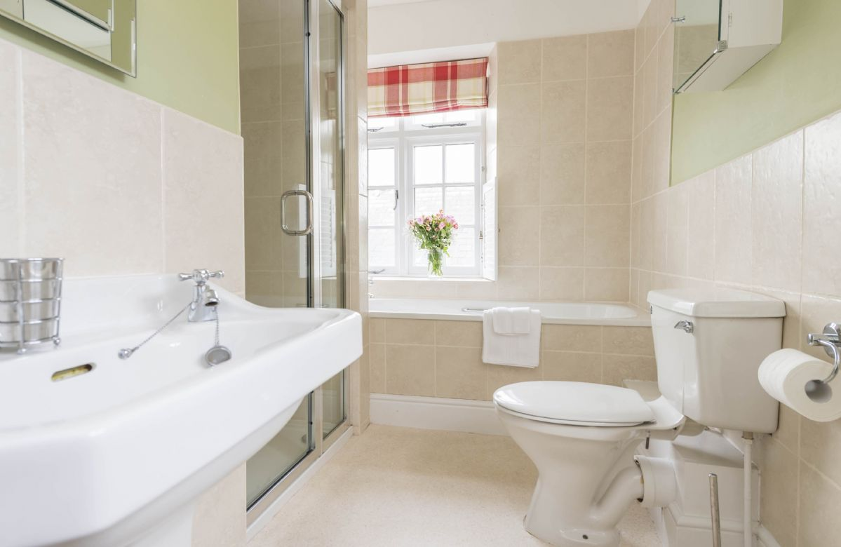 First floor: Family bathroom with bath and shower cubicle