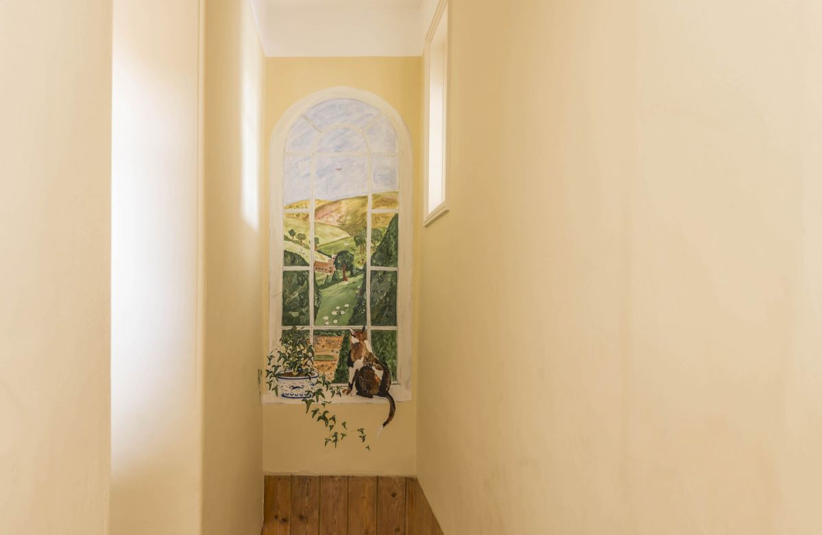 First floor: Beautiful painted mural of the gardens at Hearn Lodge