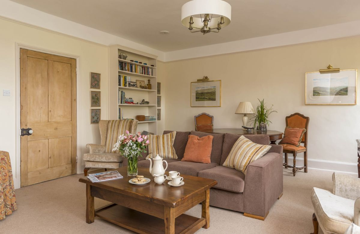 Ground floor: Spacious sitting room with wood burning stove and dining table