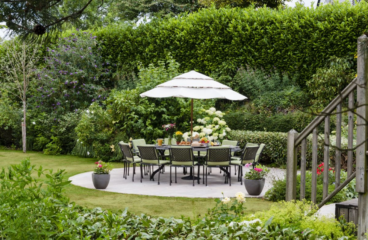 Large patio with a beautiful garden table and chairs in the private rear garden