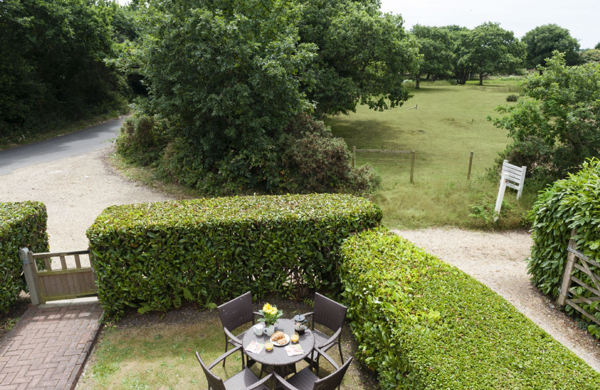 View from the house onto the beautifully landscaped hedges and front garden