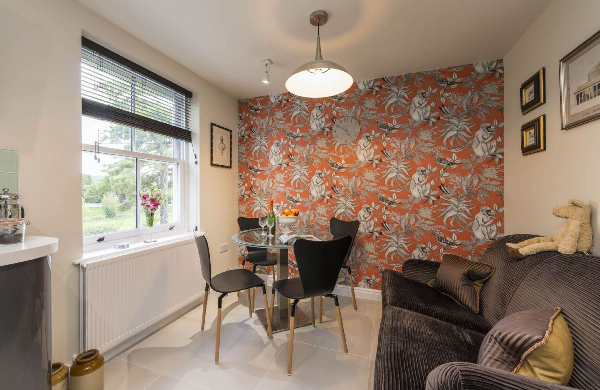 Upper ground floor: Open plan dining area with sofa seating two