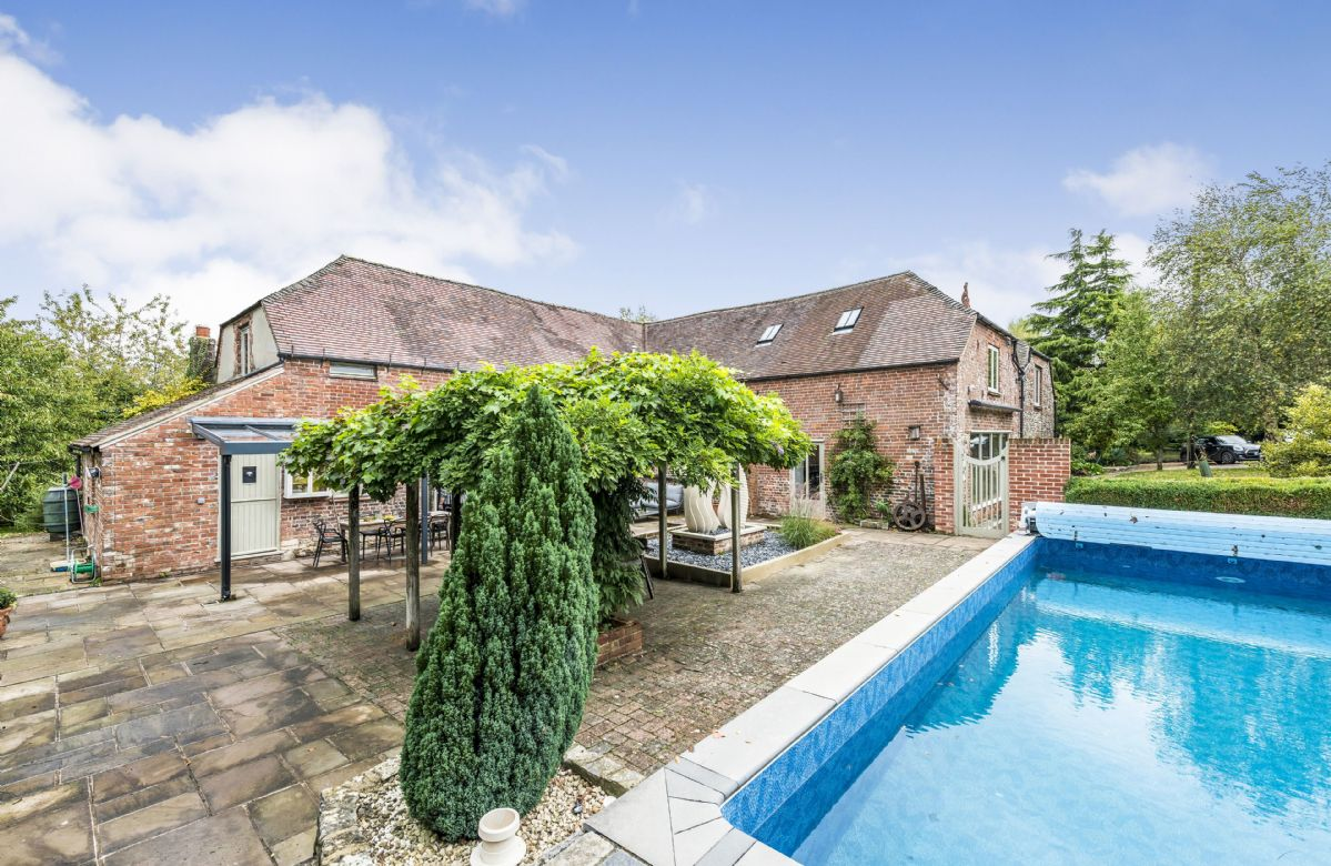 Privately designed courtyard with heated swimming pool