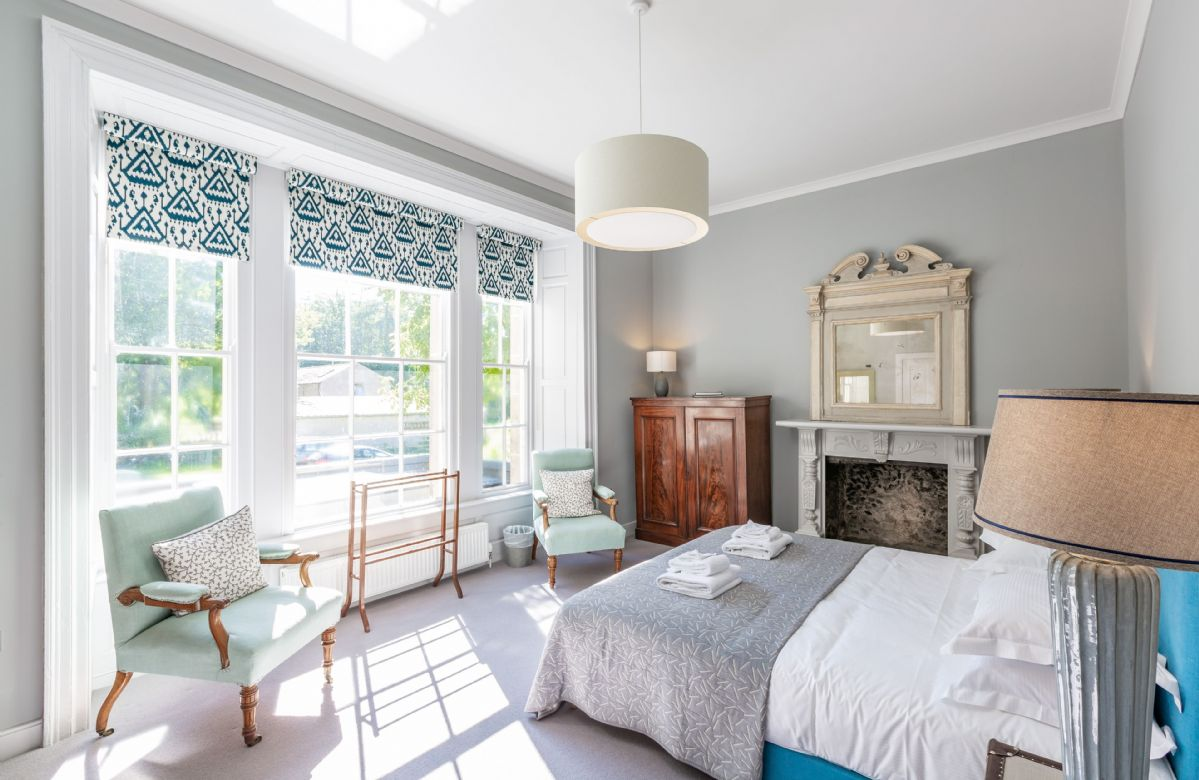 First floor: Master bedroom with 6' super king size bed and feature fireplace