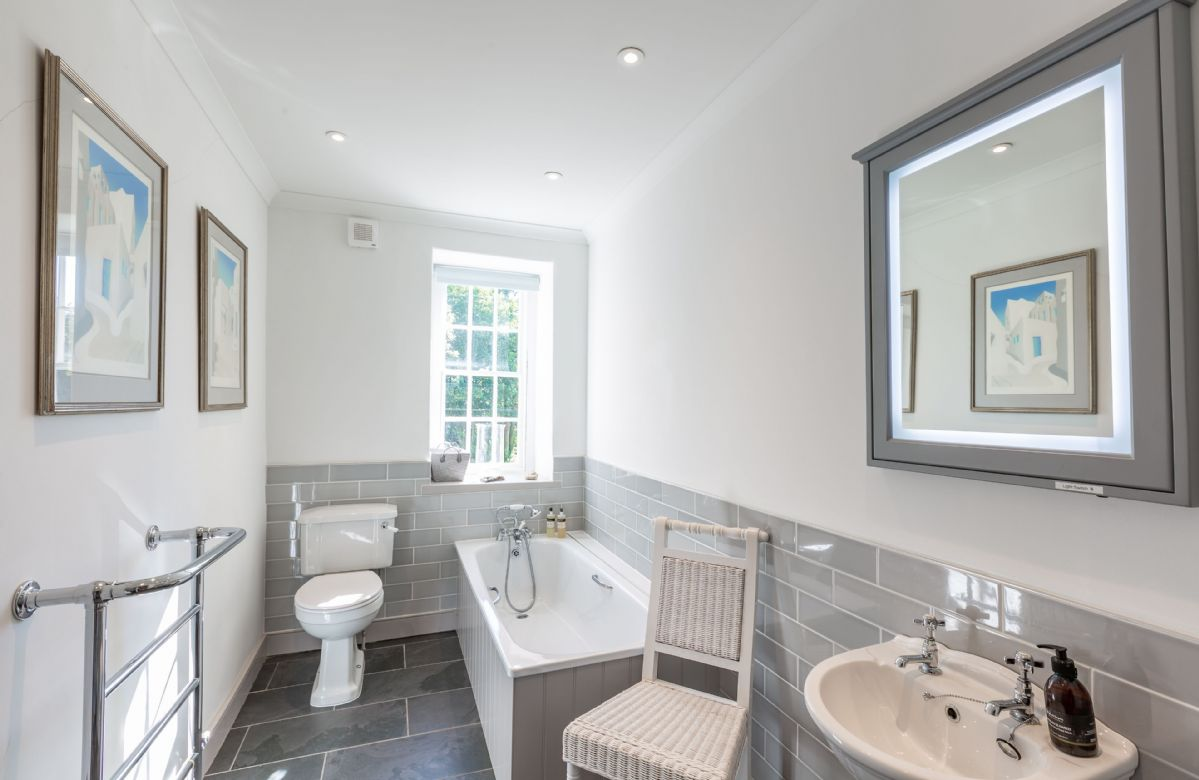 Second floor: Bathroom with large bath, shower over and heated towel rail