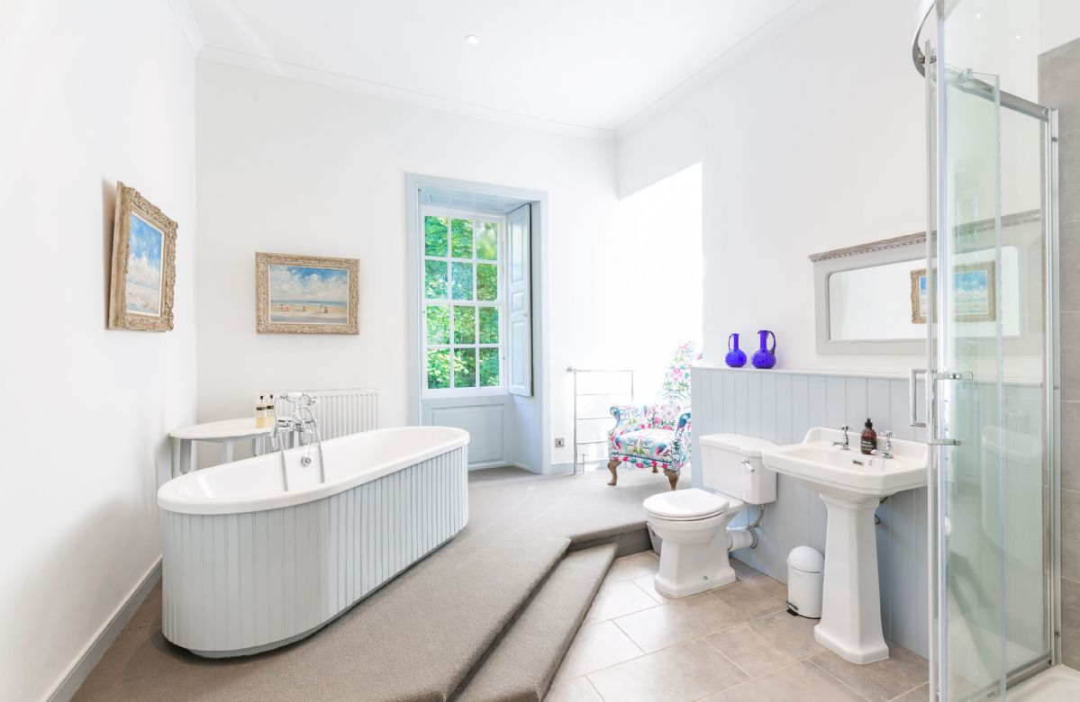 First floor: Master bathroom with large bath and large corner shower with rain forest shower