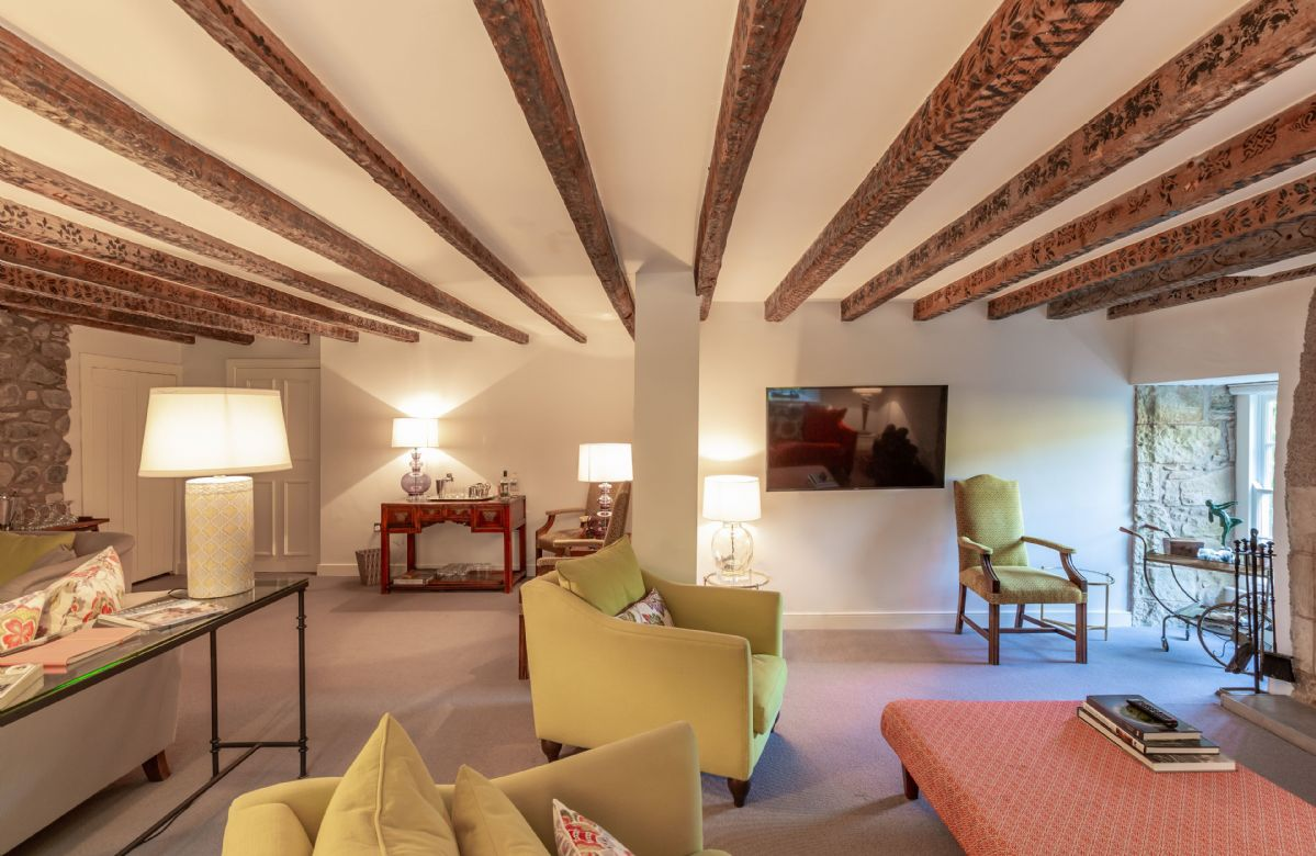 Ground floor: The oak beamed drawing room with inglenook fireplace