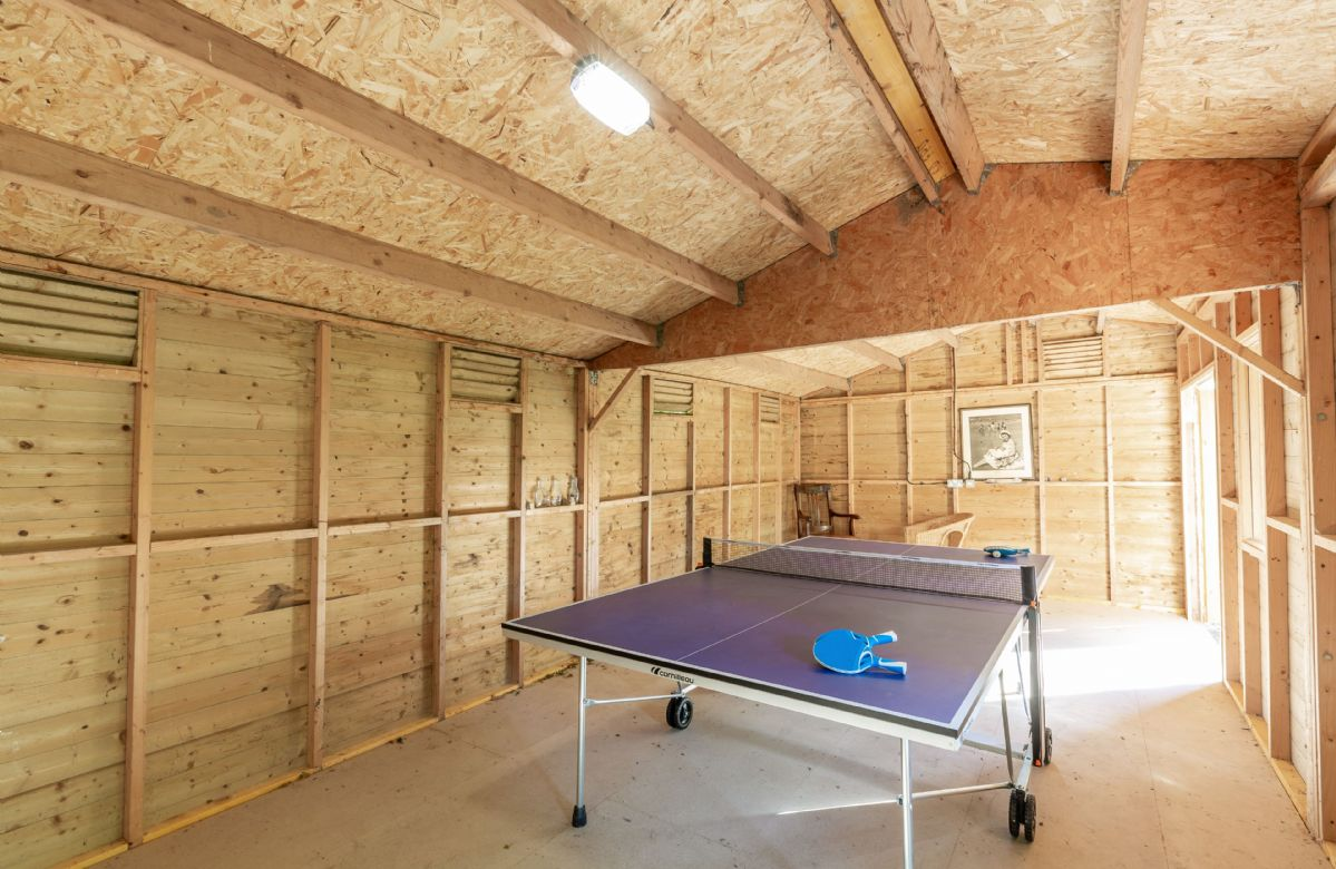 Converted stable that now functions as a games room, with a full size table tennis table