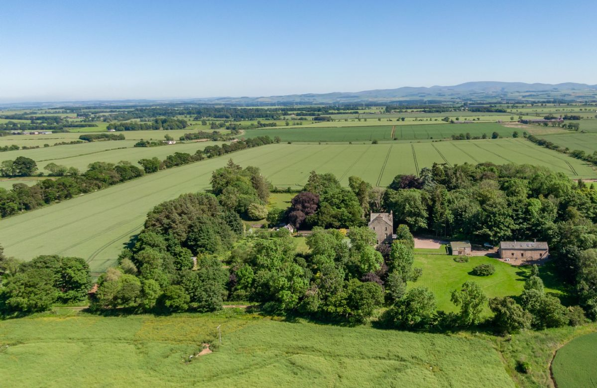 The property sits in large attractive grounds bounded by mature woodland