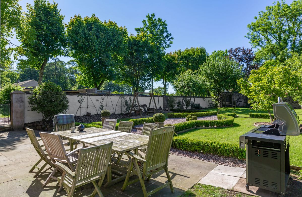 The walled garden boasts a fire pit, gas barbecue and garden furniture