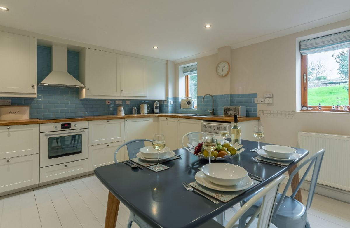 Ground floor: Large open plan kitchen and dining area seating four guests