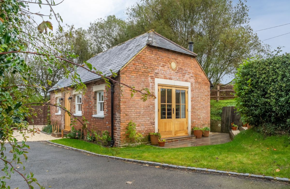 Inkpen Cottage is a detached, Grade II listed red brick building tucked away on Strawberry Hill Farm