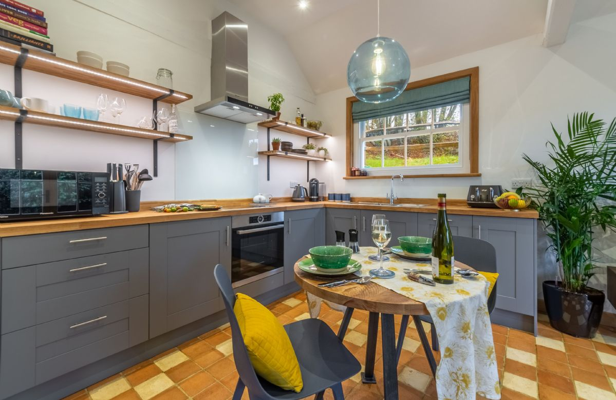 Ground floor: Open-plan kitchen with seating for two