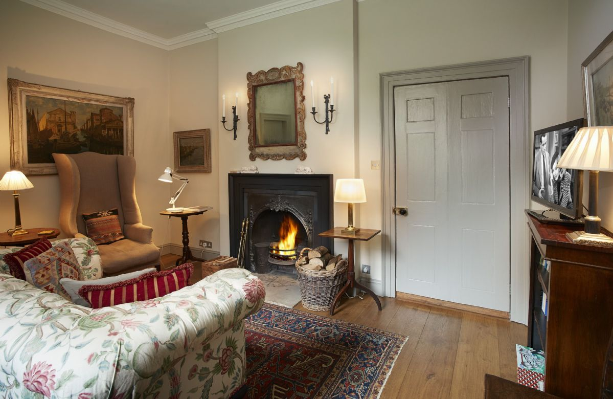 Ground floor: The splendid sitting room with open fireplace
