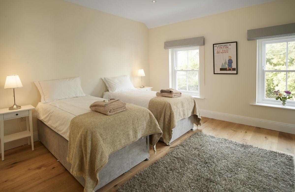 Ground floor: Bedroom with 6' super king size zip and link beds and en-suite shower room